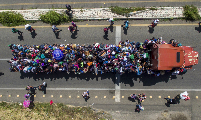 Aerial view of Honduran migrants onboard a truck as they take part in a caravan heading to the US, in the outskirts of Tapachula, on their way to Huixtla, Chiapas state, Mexico, on Oct. 22, 2018. (Pedro Pardo/AFP/Getty Images)