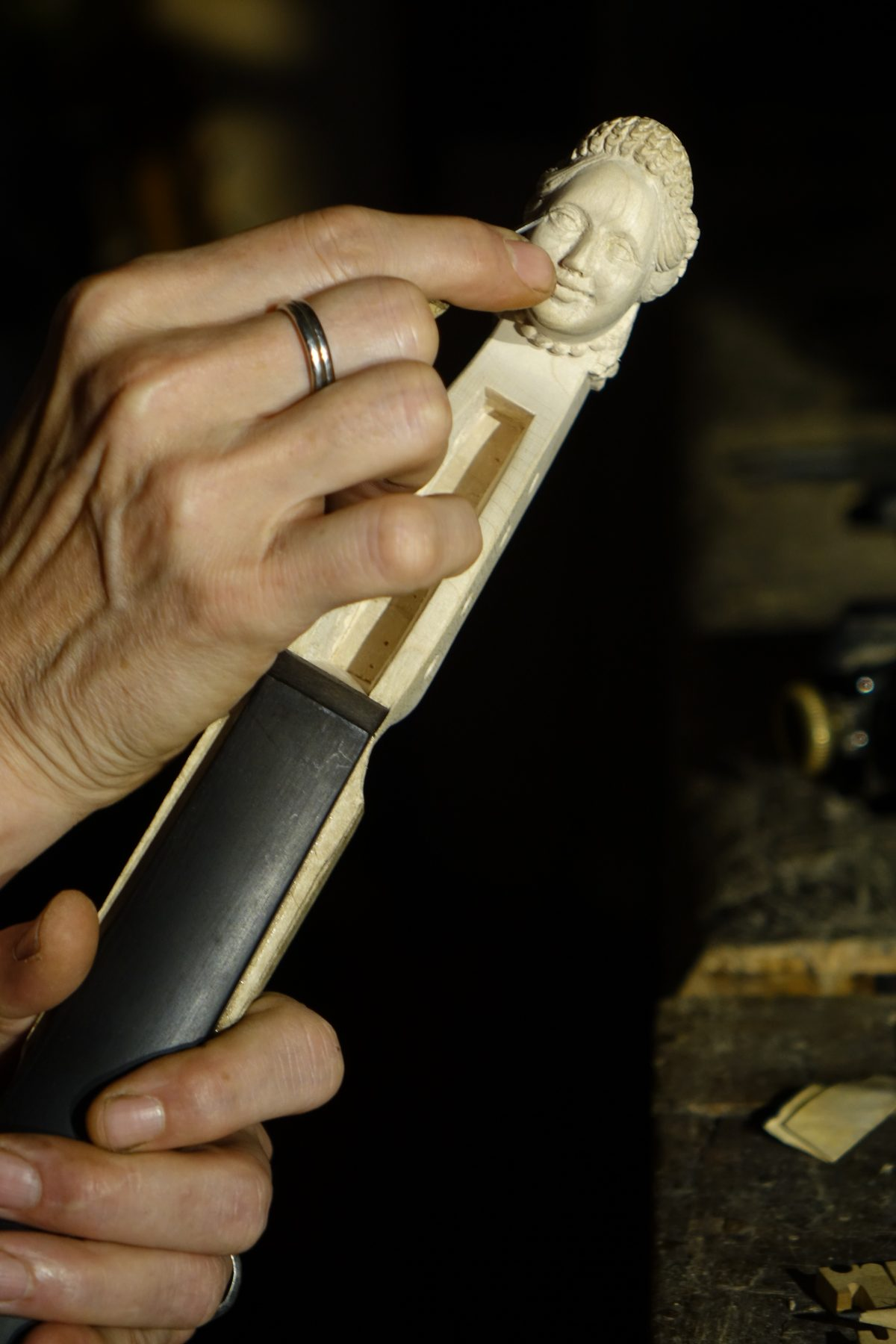 Hand carving traditional violin