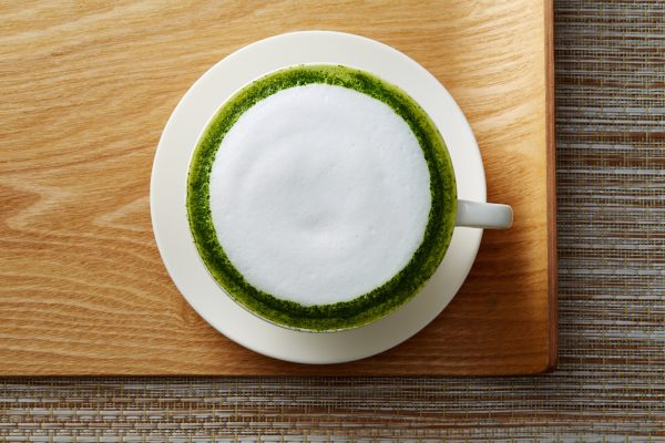 Matcha latte topped with foam