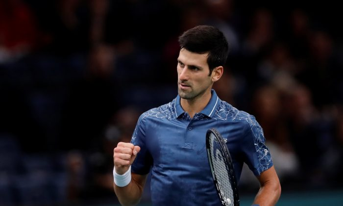 Serbia's Novak Djokovic celebrates winning his third round match after Bosnia and Herzegovina's Damir Dzumhur had to retire due to an injury at Tennis ATP 1000 Paris Masters in AccorHotels Arena, Paris, France, on Nov. 1, 2018. (Gonzalo Fuentes/Reuters)
