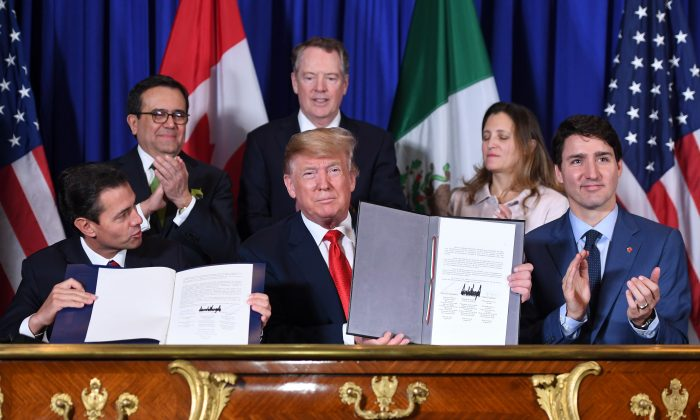 Mexico's President Enrique Pena Nieto (L), US President Donald Trump (C) and Canadian Prime Minister Justin Trudeau, sign a new free trade agreement in Buenos Aires, on the sidelines of the G20 Leaders' Summit on Nov. 30, 2018. (Saul Loeb/AFP/Getty Images)