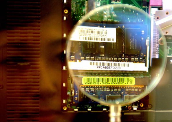 A woman looks through a magnifier to see a 2GB RAM from a notebook during the semi-tech show in Taipei, on May 10, 2007. (Sam Yeh/AFP/Getty Images)