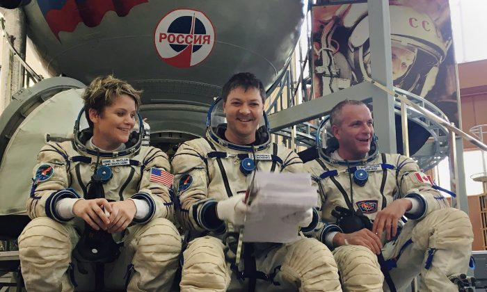 (L-R) Astronauts Anne McClain, Oleg Kononenko, and David Saint-Jacques at the Gagarin Cosmonaut Training Center in Star City, Russia, on Aug. 17, 2018. (Melanie Marquis/THE CANADIAN PRESS)