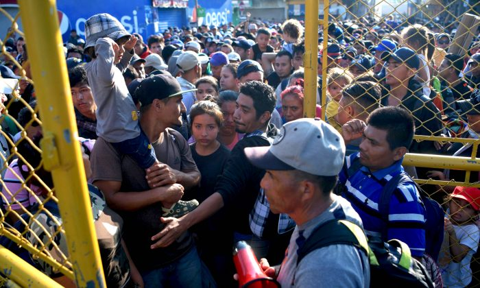 Salvadorean migrants wait to enter the Guatemala-Mexico international border bridge in Ciudad Tecun Uman, Guatemala, on Nov. 2, 2018. According to the Salvadorean General Migration Directorate (DGME), over 1,700 Salvadoreans left the country in two caravans and entered Guatemala Wednesday, in an attempt to reach the United States. (MARVIN RECINOS/AFP/Getty Images)