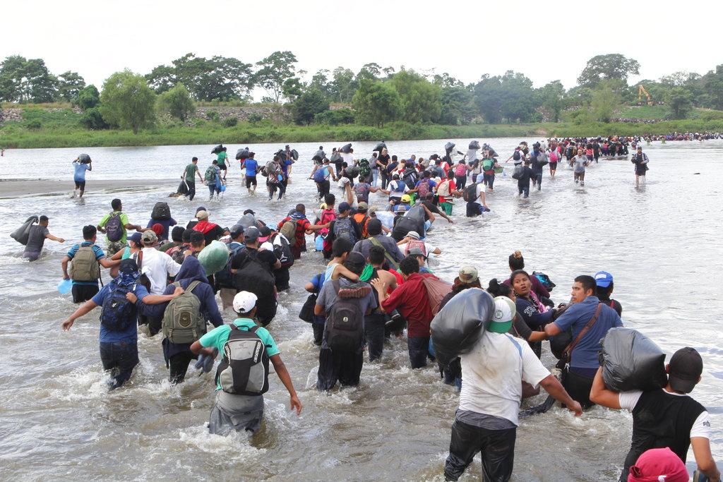 The fourth migrant caravan crossing the Suchiate River into Mexico