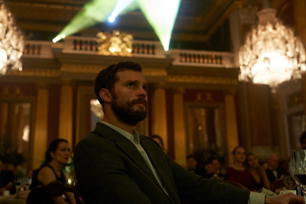 Jamie Dornan as Paul Conroy at conference