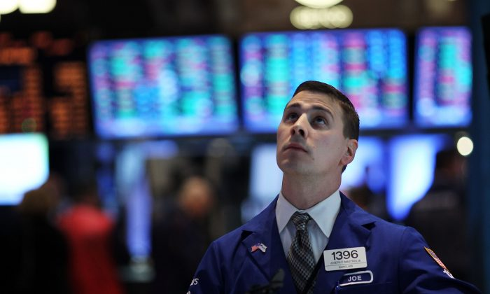 Traders on the floor of the New York Stock exchange in this file photo. How will markets react to the next financial crisis. (Spencer Platt/Getty Images)