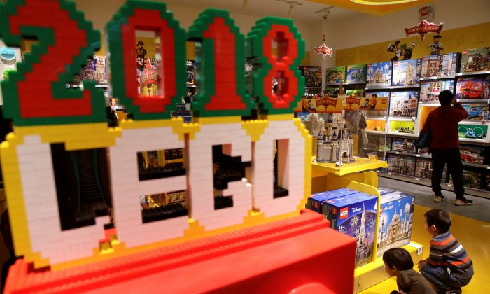 Children look at Lego boxes at a Lego store in Beijing, China Jan. 13, 2018. (Reuters/Jason Lee)