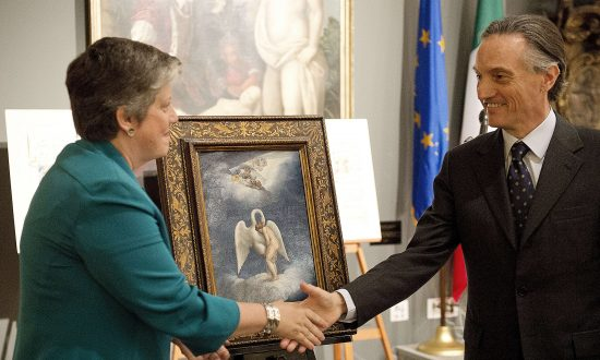 "U.S. Secretary of Homeland Security Janet Napolitano and Italian Ambassador to the U.S. Claudio Bisogniero unveil a Renaissance painting by Lelio Orsi called ""Leda and the Swan"" during a repatriation ceremony in Washington DC on April 26, 2012. (Jim Watson/AFP/Getty Images)"