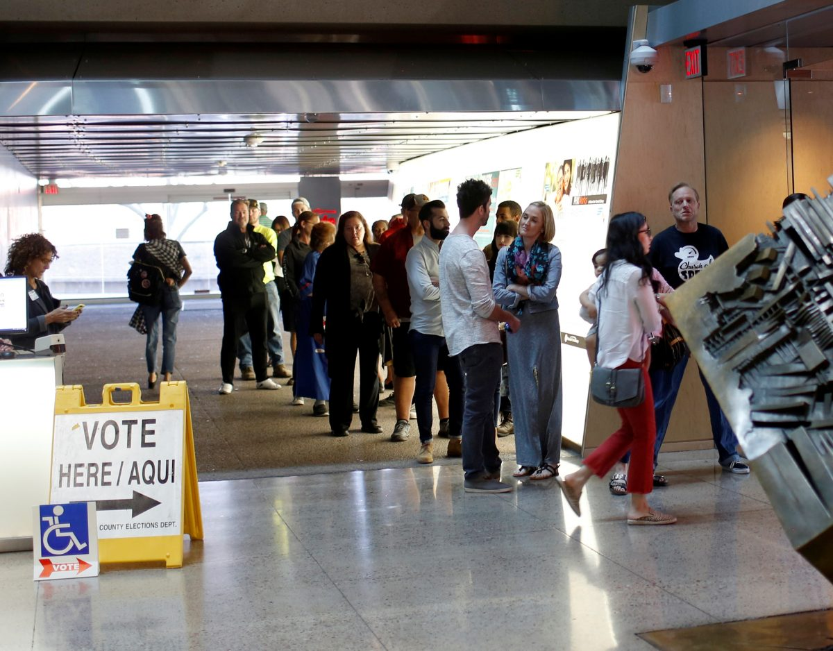Voters wait to cast their midterm elections ballots at Burton Barr Library, a polling station in Phoenix.