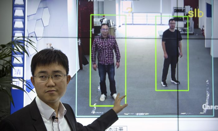 """Huang Yongzhen, CEO of Watrix, demonstrates the use of his firm's gait recognition software at his company's offices in Beijing on Oct. 31, 2018. A Chinese technology startup hopes to begin selling software that recognizes people by their body shape and how they walk, enabling identification when faces are hidden from cameras. Already used by police on the streets of Beijing and Shanghai, """"gait recognition"""" is part of a major push to develop artificial-intelligence and data-driven surveillance across China, raising concern about how far the technology will go. (Mark Schiefelbein/AP)"""