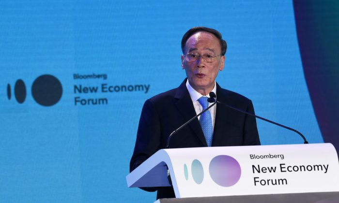 Chinese Vice-chair Wang Qishan speaks during the Bloomberg New Economy Forum in Singapore on November 6, 2018.   (ROSLAN RAHMAN/AFP/Getty Images)