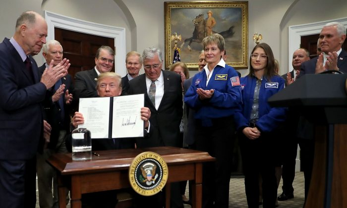 President Donald Trump holds up 'Space Policy Directive 1' after signing it during a ceremony at the White House Dec. 11, 2017. (Chip Somodevilla/Getty Images)