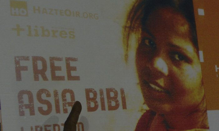 A poster of Asia Bibi in Lahore, Pakistan, on Sept. 27, 2016. (Arif Ali/AFP/Getty Images)
