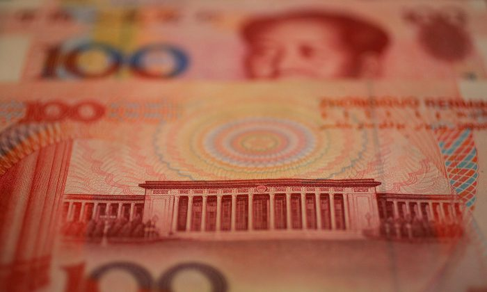 China's center of government, the Great Hall of the People, seen here in a closeup on the country's largest monetary note, a one hundred yuan (or renminbi) on May 16, 2005. (Frederic J. Brown/AFP/Getty Images)