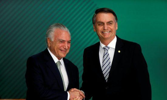 Brazil's President-elect Jair Bolsonaro (R) and Brazil's President Michel Temer shake hands, at the Planalto Palace in Brasilia, Brazil, on Nov. 7, 2018. (Adriano Machado/Reuters)