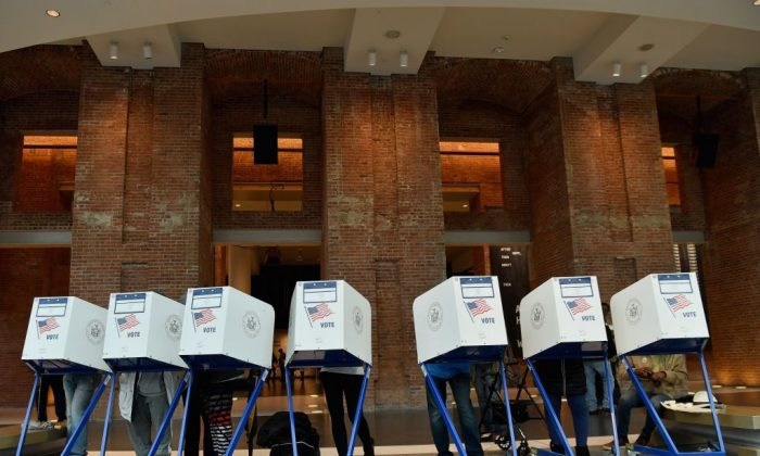 Voters cast their ballot in the midterm election at the Brooklyn Museum polling station in New York City on Nov. 6, 2018. Allegations of fraud have mired the elections, especially in Georgia and Florida. (ANGELA WEISS/AFP/Getty Images)