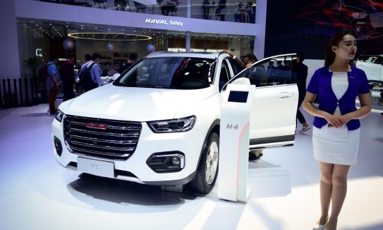 A Haval H4 car is displayed at the Beijing auto show on April 25, 2018. - Global carmakers touted their latest electric and SUV models in Beijing as they warily welcomed China's promise of better foreign access to the world's largest auto market, where domestic vehicles are making major inroads. Industry behemoths like Volkswagen, Daimler, Toyota, Nissan, Ford and others are displaying more than 1,000 models and dozens of concept cars at the Beijing auto show. (Photo by WANG ZHAO / AFP)        (Photo credit should read WANG ZHAO/AFP/Getty Images)