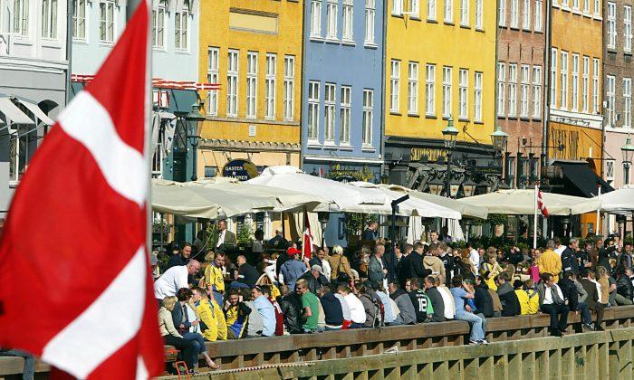 The Danish flag flies over Nyhavn canal area  in Copenhagen on May 13, 2004. (Odd Andersen/AFP/Getty Images)