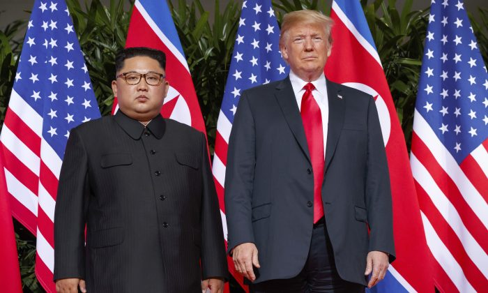 President Donald Trump stands with North Korean leader Kim Jong Un on Sentosa Island in Singapore, on June 12, 2018. (Evan Vucci/AP)
