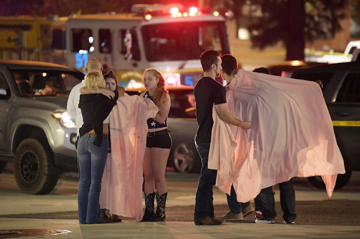 people comfort each other after the mass shooting at Thousand Oaks