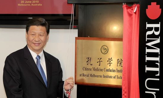 China's then vice President Xi Jinping unveils a plaque at the opening of Australia's first Chinese Medicine Confucius Institute at the RMIT University in Melbourne on June 20, 2010. The Confucius Institutes are one method of the Chinese regime exerting influence abroad. (WILLIAM WEST/AFP/Getty Images)