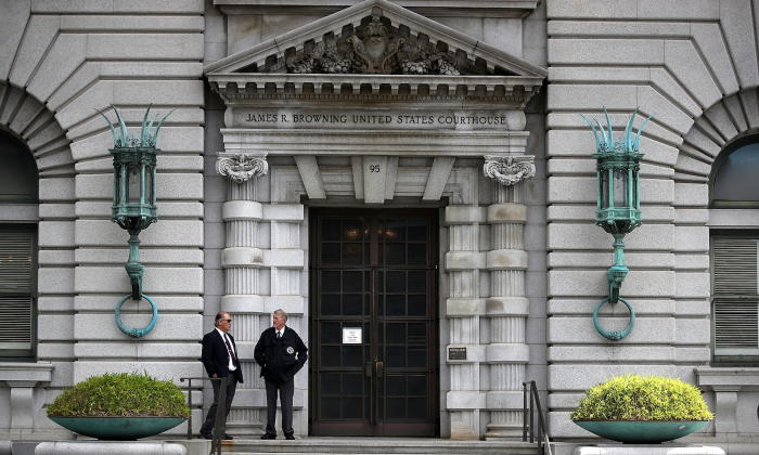 Security guards stand in front of the Ninth U.S. Circuit Court of Appeals on June 12, 2017 in San Francisco, California.      Justin Sullivan/Getty Images
