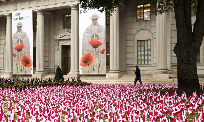 Thousands of Canadian flags honouring fallen soldiers are planted on the front lawn of the Manulife head office in downtown Toronto on Wednesday, Nov. 7, 2018. (Nathan Denette/The Canadian Press)