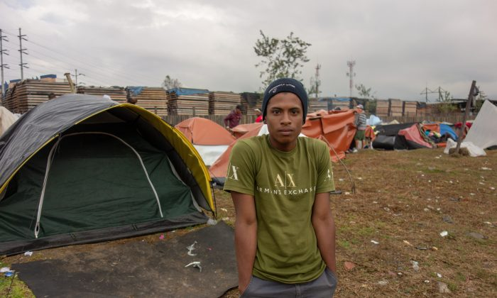 Jose Urdaneta, a 19-year-old Venezuelan living in an improvised refugee camp in Bogota, Colombia, on Nov. 9, 2018. (Luke Taylor/Special to The Epoch Times)
