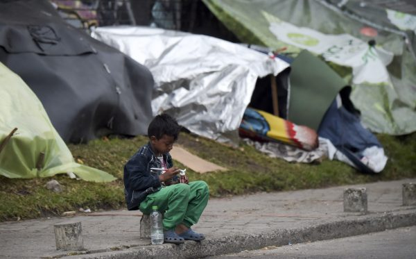 A Venezuelan migrant child prepares to brush his teeth.