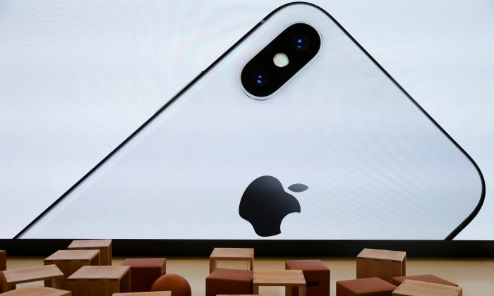 An iPhone X is seen on a large video screen in the new Apple Visitor Center in Cupertino, California, on Nov. 17, 2017. (Elijah Nouvelage/Reuters)