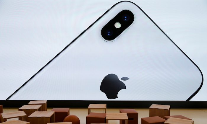An iPhone X is seen on a large video screen in the new Apple Visitor Center in Cupertino, California, on Nov. 17, 2017. (REUTERS/Elijah Nouvelage)