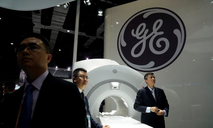 A General Electric sign during the China International Import Expo in Shanghai on Nov. 6, 2018. Federal prosecutors charged two Chinese men with stealing information related to GE's turbine technology for the benefit of the Chinese regime. (Aly Song/Reuters)