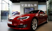 Self-Driving Tesla Allegedly Hits Robot, People Claim Viral Video Is a PR Stunt