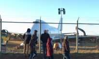 Crowd Watches as Backhoe Rips Into Mangled Plane After Halifax Runway Overrun
