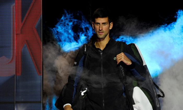 Serbia'sNovakDjokovic makes his entrance for his group stage match against JohnIsner of the U.S.   on ATP Finals in London, Britain on Nov. 12, 2018. (Action Images via Tony O'Brien/Reuters)