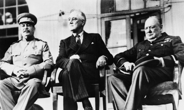 """The historic meeting of the """"Big Three"""" in Tehran, Iran, in December 1943. (L–R) Soviet dictator Josef Stalin (1879–1953), U.S. President Franklin Delano Roosevelt (1882–1945), and British Prime Minister Winston Churchill (1874–1965). The three leaders met in person for the first time to discuss the co-ordination of Allied war efforts and the post-war aims of their respective countries.     (Keystone/Hulton Archive/Getty Images)"""