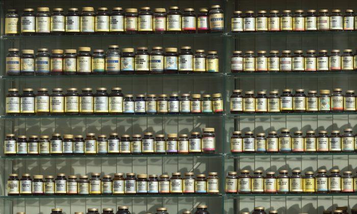 A pharmacy wall full of supplements. (Angel Sinigersky/Unsplash)