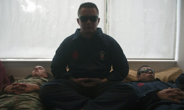 Colombian soldiers meditate during a yoga session in Bogota. (Eitan Abramovich/AFP/Getty Images)