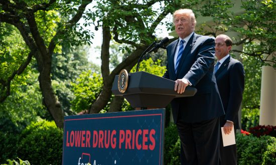 U.S. President Donald Trump delivers remarks with Health and Human Services Secretary Alex Azar (R) on reducing drug costs in the Rose Garden at the White House in Washington, DC, on May 11, 2018. (NICHOLAS KAMM/AFP/Getty Images)