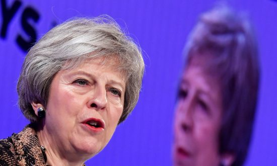 UK's May Sticks to Brexit Deal as Opponents Seek to Trigger Formal Challenge