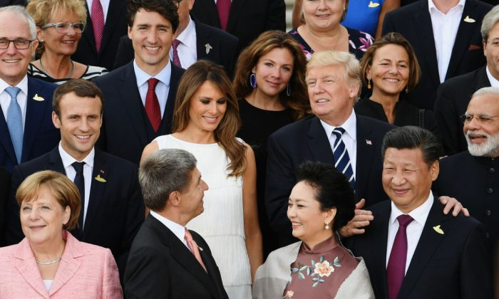 U.S. President Donald Trump and First Lady Melania (C) pose with G-20 leaders and their spouses upon their arrival at the Elbphilharmonie philharmonic concert hall on the first day of the G-20 economic summit in Hamburg, Germany, on July 7, 2017. (Stefan Rousseau - Pool / Getty Images)