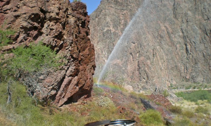 Rainbow visible from water spraying from a break in the Trans-canyon Waterline along the North Kaibab Trail. (NPS)