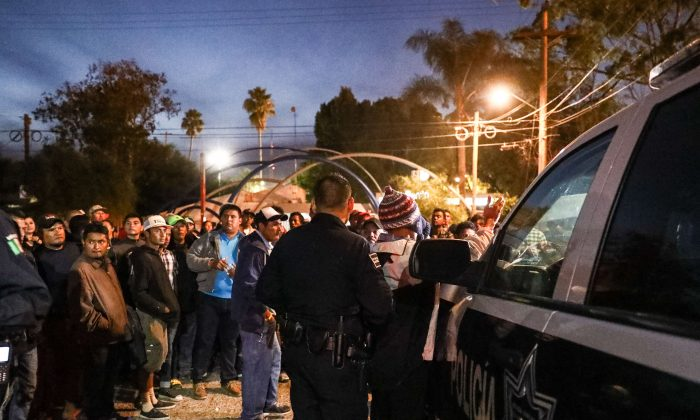 Tijuana municipal police arrest two members of a migrant caravan for alleged marijuana possession at a municipal sports complex in Tijuana, Mexico, on Nov. 17, 2018. (Charlotte Cuthbertson/The Epoch Times)
