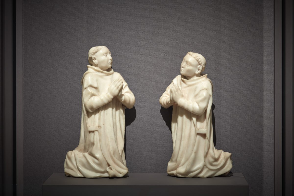 """""""Kneeling Carthusian Monks,"""" circa 1380–1400, by unknown artist from Burgundy. Marble, (L) 10 1/16 inches by 5 1/2 by 2 5/8 inches; (R) 9 1/2 inches by 5 3/4 inches by 2 15/16 inches, The Cleveland Museum of Art. (Courtesy of The Frick Collection)"""