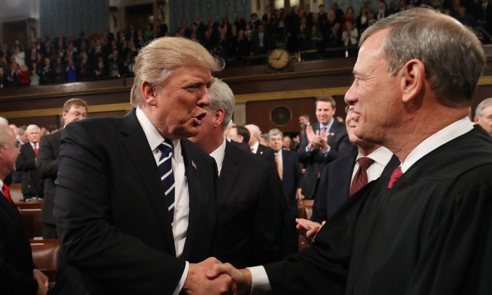President Donald Trump (L) shakes hands with Chief Justice John Roberts (R) in the House chamber of the U.S. Capitol on Feb. 28, 2017. (Jim Lo Scalzo - Pool/Getty Images)