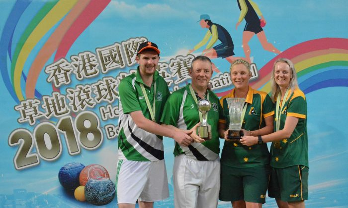 CAPTION:  (L-R) Irishmen Aaron Tennant, Ian McClure and Australians Natasha Scott and Ellen Ryan happily display their Pairs trophies of the Hong Kong International Bowls Classic after winning their respective finals at Craigengower Cricket Club on Sunday, Nov 18, 2018. (Stephanie Worth)
