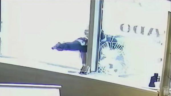 suspect brandishes a handgun