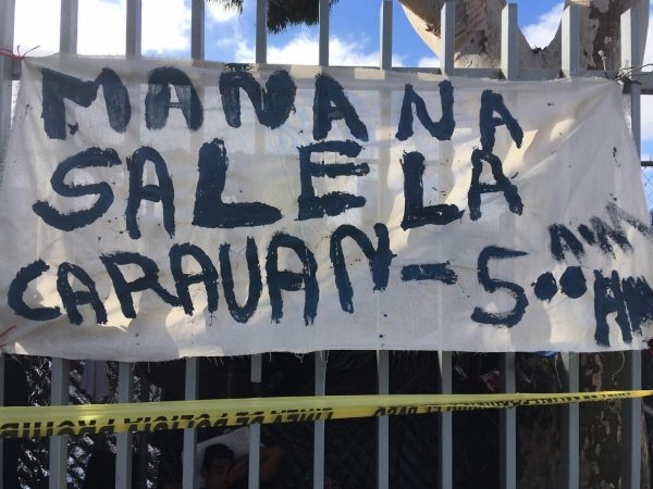 A-hand-painted-sign-on-the-fence-around-the-sports-complex-where-up-to-5000-migrants-are-camping-out-in-Tijuana-Mexico-1200x900