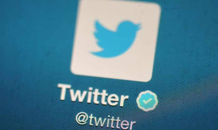 A file photo of the Twitter logo displayed on a mobile device in London, England, on Nov. 7, 2013. (Bethany Clarke/Getty Images)